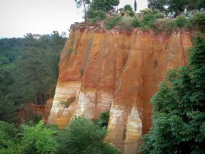 Roussillon - Ochre cliffs and peaks of the Fées valley, trees