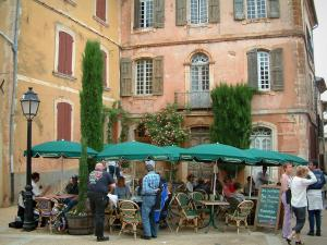 Roussillon - Square with café terrace and houses with ochre facades