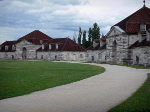 Royal saltworks of Arc-et-Senans - Path lined with lawns and buildings of the former royal saltworks