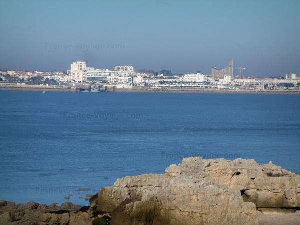 Royan - Cliffs in foreground, sea (confluence of the Gironde estuary and the Atlantic Ocean), Notre-Dame church, houses and buildings of the seaside resort