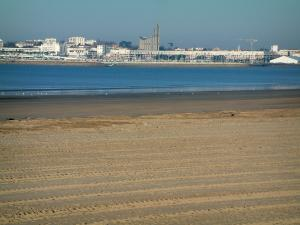 Royan - Sandy beach, sea (confluence of the Gironde estuary and the Atlantic Ocean), port, Notre-Dame church, houses and buildings of the seaside resort