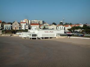 Royan - Sandy beach (Pontaillac conche), the Casino of Royan and houses of the seaside resort