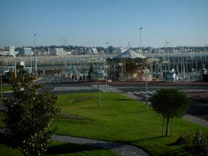 Royan - Lawns, shrubs, road, carousel, port and beach of the Grande Conche in background