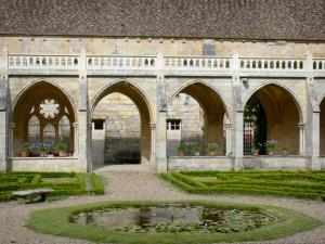 Royaumont abbey - Gothic cloister and its French-style formal garden with a pond; in the town of Asnières-sur-Oise; in the Oise-Pays de France Regional Nature Park