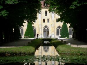 Royaumont abbey - Building of the monks (bâtiment des pères) reflected in the canal waters, and trees; in the town of Asnières-sur-Oise; in the Oise-Pays de France Regional Nature Park