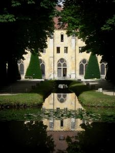 Royaumont abbey - Building of the monks (bâtiment des pères) reflected in the canal waters, and trees