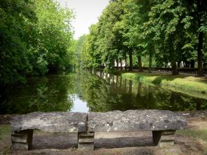 Royaumont abbey - Canal bordered by trees and stone bench beside the water; in the town of Asnières-sur-Oise; in the Oise-Pays de France Regional Nature Park