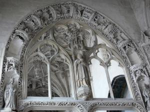 Rue - Inside of the Saint-Esprit chapel of Flamboyant Gothic style: statuary (statues, sculptures) and hanging carved keystones in background