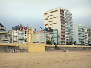 Les Sables-d'Olonne - Sandy beach, clock tower, flags, houses and buildings of the seaside resort