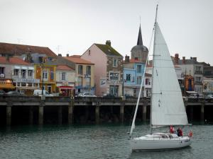 Les Sables-d'Olonne - Sailboat navigating, bell tower and houses of the Chaume district