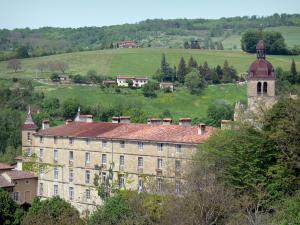 Saint-Antoine-l'Abbaye - Convent building, tower of the abbey church, trees and meadows