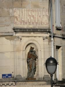 Saint-Dizier - Statue of the Virgin and Child in Rue Notre-Dame street, lamppost and old sign