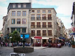 Saint-Étienne - Facades of houses, café terraces and fountain of the Neuve square