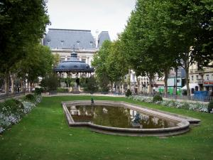 Saint-Étienne - Jean-Jaurès square: pond lined with lawn, flowers and trees, bandstand and Prefecture building