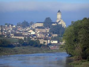 Saint-Florent-le-Vieil - Abbey church, houses of the city, the Loire River and trees along the water (Loire valley)