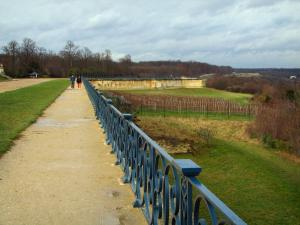 Saint-Germain-en-Laye - Rail of the Terrace of the park of the castle with a cloudy sky