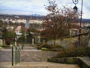 Saint-Germain-en-Laye - Stairs, lampposts and trees with view of the River Seine, the West of Paris and the towers of La Défense in background