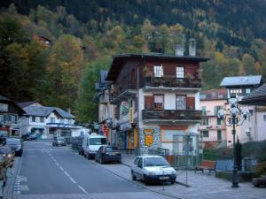 Saint-Gervais-les-Bains - Street of the spa town with houses and forest