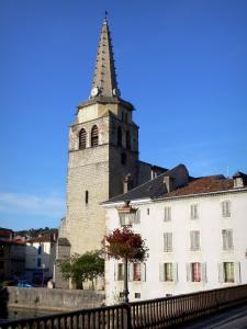 Saint-Girons - Bell tower of the Saint-Girons church, facades, flower-decked lamppost and bridge