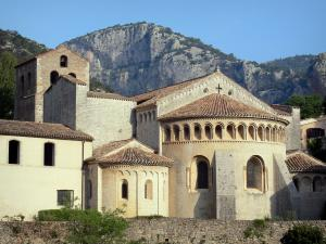 Saint-Guilhem-le-Désert - Chevet of the abbey church (Gellone abbey) of Romanesque style, cliffs (rock faces) in background