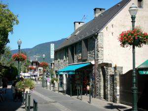 Saint-Lary-Soulan - Spa town and ski resort: village street lined with houses and lampposts with flowers ; in the Aure valley