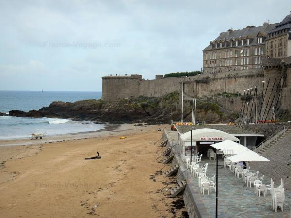 Saint-Malo - Sandy beach, café terrace, cliffs, bastion, ramparts and buildings of the malouine corsair town