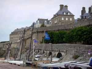 Saint-Malo - Catamarans at the foot of the ramparts and buildings of the malouine corsair town