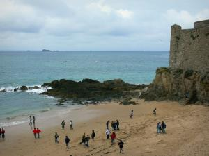 Saint-Malo - Sandy beach and fortification of the malouine corsair town, cliffs, sea and cloudy sky