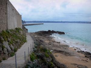 Saint-Malo - Fortification of the malouine corsair town, path leading to the sea, cliffs, coast in background