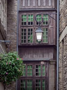 Saint-Malo - Walled town: lamppost, flowers and facades of houses in the old town (malouine corsair town)