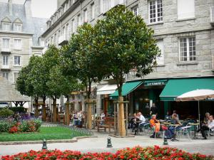 Saint-Malo - Walled town: café terrace, flower garden, trees and buildings of the malouine corsair town