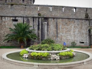 Saint-Malo - Fortification of the castle, palm tree and flower-bedecked fountain