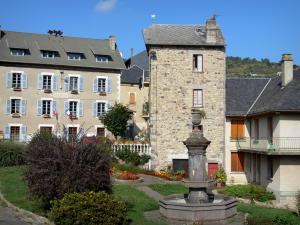 Saint-Nectaire - Town hall, fountain and houses in the village of Saint-Nectaire-le-Haut, in the Auvergne Volcanic Regional Nature Park, in the Monts Dore mountain area