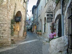 Saint-Paul-de-Vence - Narrow paved street in the village lined with shops