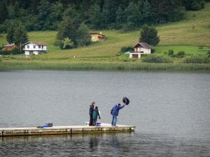 Saint-Point lake - Houses looking onto the Malbuisson lake (natural lake), fishermen on the pontoon