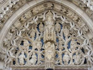Saint-Riquier - Facade of the Saint-Riquier abbey church of Flamboyant Gothic style: tympanum carved of the central portal