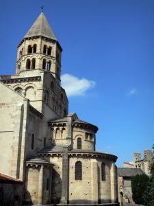 Saint-Saturnin - Octagonal bell tower with two floors and apse of the Saint-Saturnin Romanesque church; in the Auvergne Volcanic Regional Nature Park