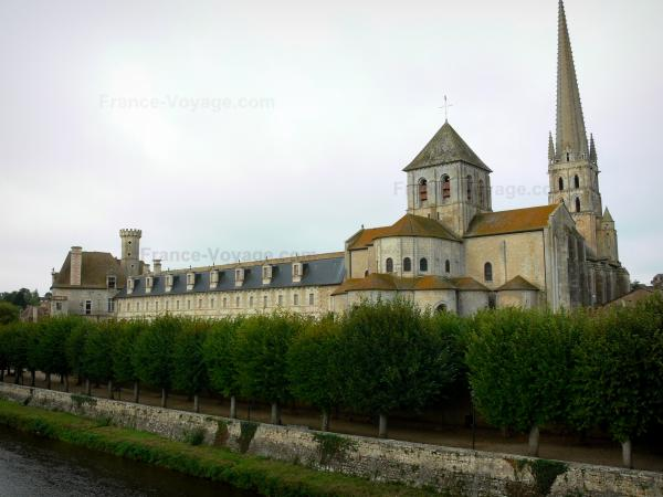 Saint-Savin abbey - Abbey church with its stony bell tower, monastic buildings, line of trees and the River Gartempe