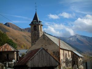 Saint-Sorlin-d'Arves - Saint-Saturnin Baroque church, houses of the village, mountains and clouds in the sky
