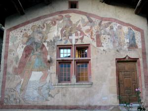 Saint-Sorlin-en-Bugey - St. Christopher fresco adorning the facade of a house in the village; in Lower Bugey