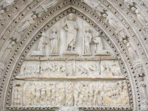 Saint-Sulpice-de-Favières church - Carved tympanum of the portal of the Saint-Sulpice church depicting the Last Judgement