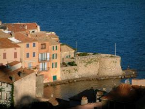 Saint-Tropez - View of the colourful houses in the Ponche district, the Vieille tower and the Mediterranean Sea