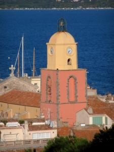 Saint-Tropez - Church bell tower with bright colours, houses of the old town and the Mediterranean Sea