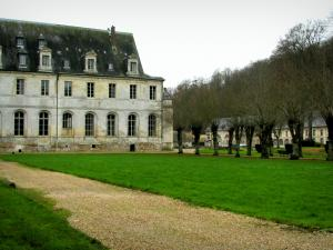 Saint-Wandrille abbey - Convent building, path lined with lawns and trees, in the Norman Seine River Meanders Regional Nature Park