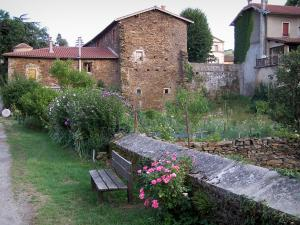 Sainte-Croix-en-Jarez - Bench, flowers, garden and houses; in the Regional Natural reserve of Pilat