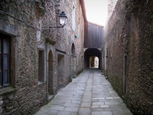 Sainte-Croix-en-Jarez - Narrow street (corridor) and buildings of the former Carthusian monastery (former convent); in the Regional Natural reserve of Pilat