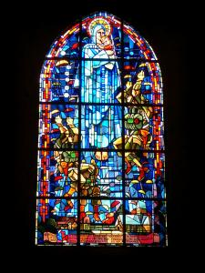 Sainte-Mère-Église - Stained glass window of the parachutists, in the church of the village