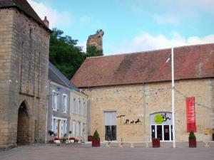 Sainte-Sévère-sur-Indre - Facade of the House of the 'Jour de Fête' movie by Jacques Tati), houses, fortified gate, and keep (remains of the castle) overlooking the place