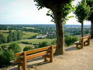 Sainte-Suzanne - Poterne promenade with benches and trees, view of the surrounding green landscape