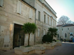 Saintes - The Échevinage museum (Fine art museum), shrubs and media library in background
